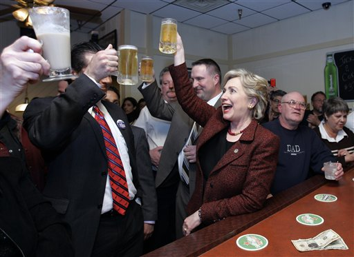 Clinton enjoys a beer!